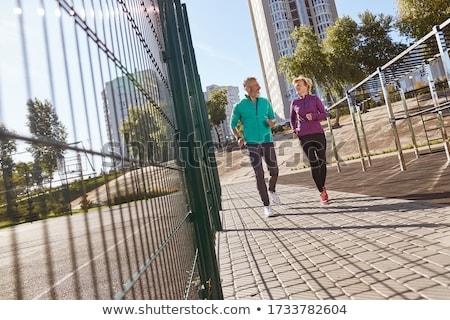 couple doing full fitness workout in outdoor gym stock photo © kzenon