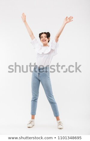 Stock photo: Full Length Photo Of Joyful Girl 20s With Double Buns Hairstyle
