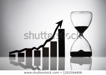 Hourglass Near Graph With Arrow Moving In Upward Direction Stock photo © AndreyPopov