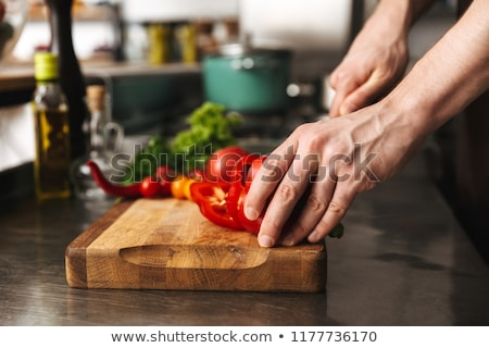 Közelkép férfi szakács kezek tapsolás zöldségek Stock fotó © deandrobot