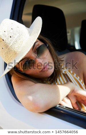 Image of fashionable brunette woman 20s in straw hat and sunglas Stock photo © deandrobot