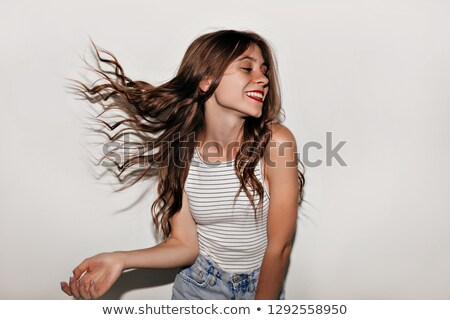 Photo stock: Portrait Of Charming Brunette Girl 20s With Long Hair Wearing Dr