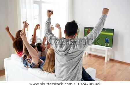 Donna bere birra guardare calcio gioco Foto d'archivio © dolgachov