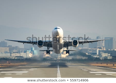 an airplane taking off runway stock photo © colematt