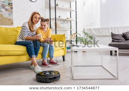 Nő okostelefon porszívó otthon takarítás háztartás Stock fotó © dolgachov