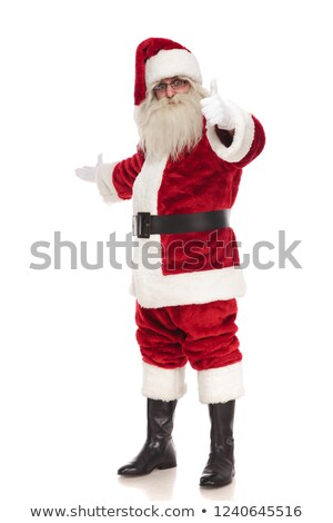happy santa claus points finger and makes inviting gesture Stock photo © feedough