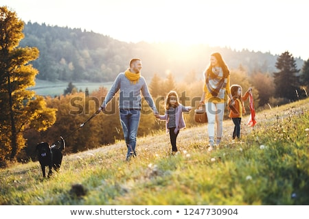 happy family mother father two daughters and dog stock photo © robuart
