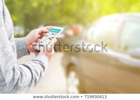 Person Using Car Sharing Application On Mobile Phone Stock photo © AndreyPopov