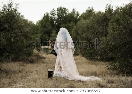 Image of creepy woman on halloween wearing wedding dress and sca Stock photo © deandrobot