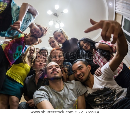 Couple enjoying the food at a house party Stock photo © Kzenon