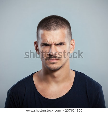 Young man frowning in front of the camera Stock photo © feedough