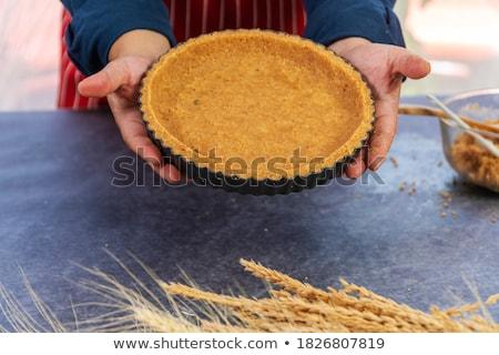 Woman holding tarts and cake in tray Stock photo © Kzenon