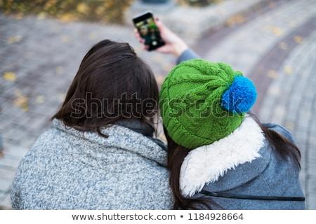 outdoors fashion portrait of two young beautiful women friends d stock photo © hsfelix