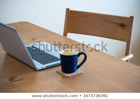 labtop on table and chair stock photo © arsgera