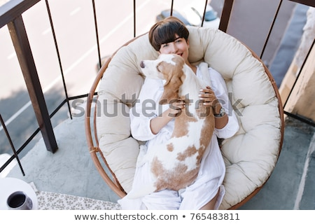 the girl with a pillow and white puppy in her arms stock photo © elenabatkova