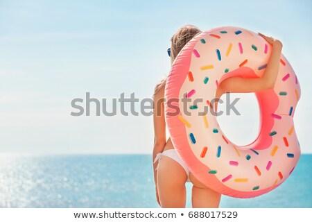 Mulher azul biquíni maiô inflável rosquinha Foto stock © robuart