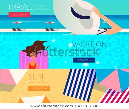 Mulher jovem praia seis guarda-sol bandeira longo Foto stock © galitskaya