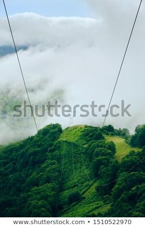 Power Line Pylon On Peak Of Mountain With Stormy Weather Stock photo © diego_cervo