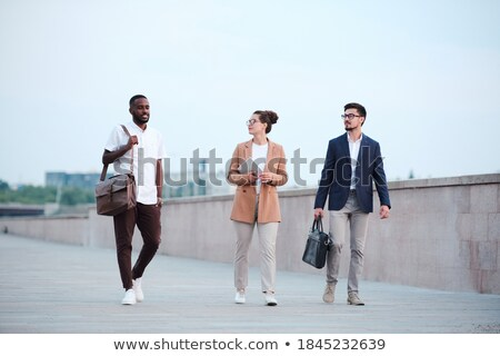 Business team of three young intercultural colleagues in formalwear Stock photo © pressmaster
