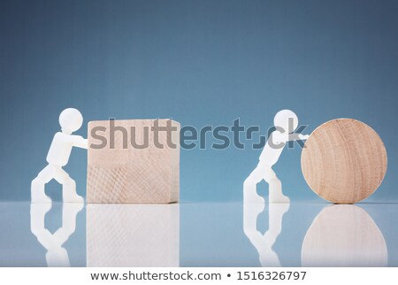 Two Human Figure Pushing Wooden Block And Circle Stock photo © AndreyPopov