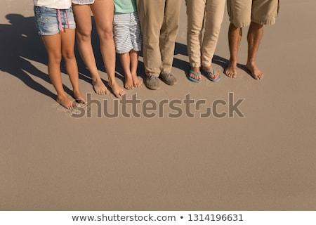 低い セクション 家族 立って ビーチ 日照 ストックフォト © wavebreak_media