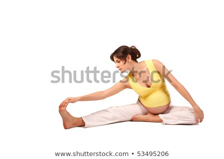 beautiful brunette pregnant woman stretching and practicing yoga stock photo © dashapetrenko