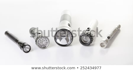 black flashlight over a gray background on the floor Stock photo © Lopolo