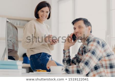 Horizontal shot of husband and wife analyze utilities bills, study bank loan documents, manage finan Stock photo © vkstudio