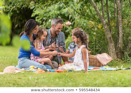 happy family with picnic basket in summer park Stock photo © dolgachov