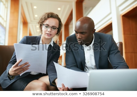 Portrait of two businesswomen analyzing a report. Stock photo © HASLOO