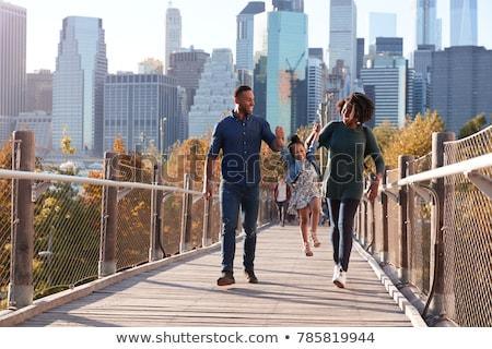 молодым человеком пешеходный мост город стекла промышленности время Сток-фото © Paha_L