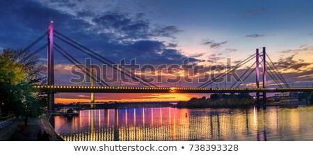 pôr · do · sol · rio · silhuetas · guindaste · porta · laranja - foto stock © simply