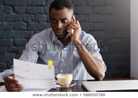 businessman calls someone Stock photo © goryhater