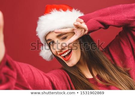 young woman wearing santas hat making funny face Stock photo © Rob_Stark