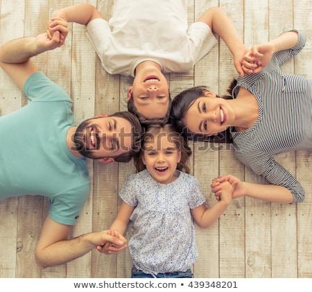 sorridente · família · juntos · piso · sala · de · estar · crianças - foto stock © get4net