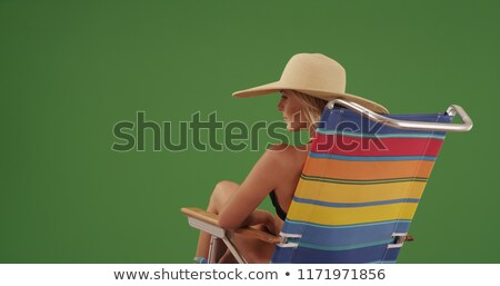 Rear view of a blond woman wearing a white bikini Stock photo © RTimages