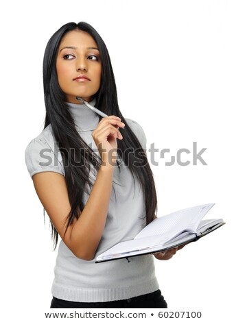Woman wondering what to write in her book Stock photo © photography33