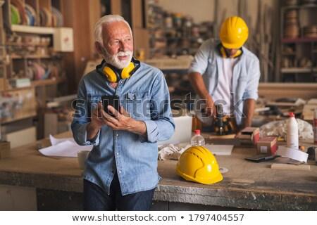 Artesão aprendiz pensando homens ferramentas trabalhando Foto stock © photography33
