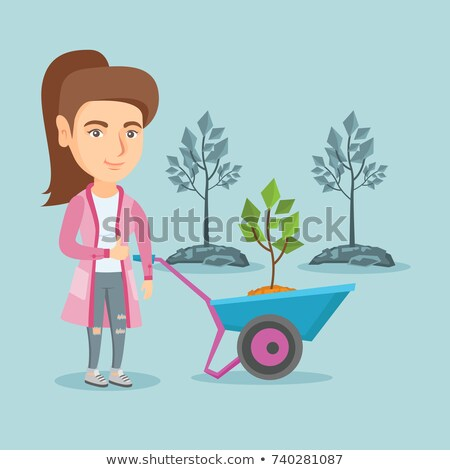 Woman with wheelbarrow giving thumbs-up Stock photo © photography33