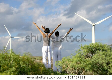Couple doing yoga by wind farm Stock photo © photography33