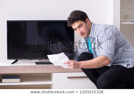 Husband fixing the TV. Stock photo © photography33