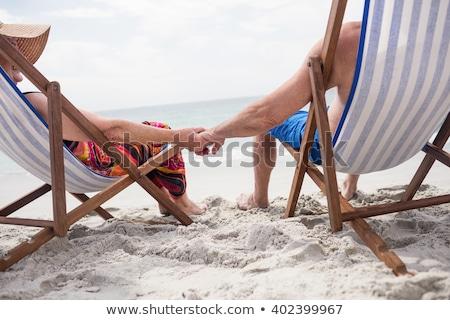 Paar ligstoel meisje liefde man tuin Stockfoto © photography33