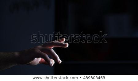 Hands And The Dark Background Stock photo © sdecoret