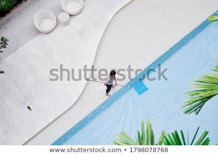piscina · limpador · céu · casa · homem · montanha - foto stock © ruzanna