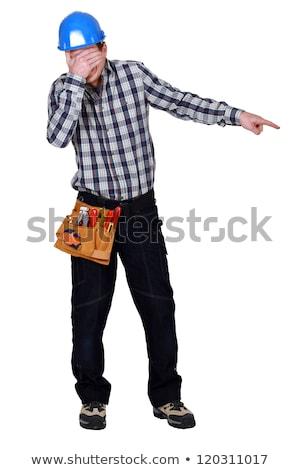 Construction worker covering his eyes and pointing at something Stock photo © photography33