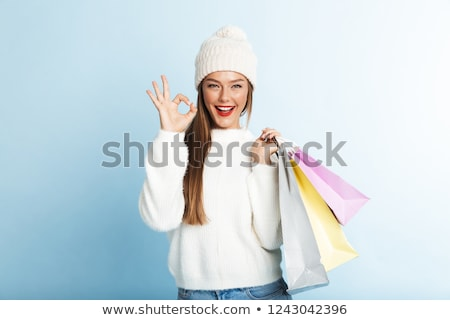 pretty girl santa claus standing with shopping bag stock photo © carlodapino