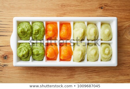 Ice cube and carrot stock photo © Givaga