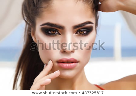 woman concealing mouth Stock photo © feedough