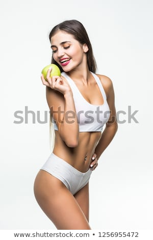 Woman perfect shaped legs on scale with apple Stock photo © rozbyshaka