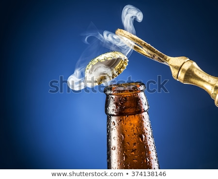 golden bottle opener Stock photo © shutswis